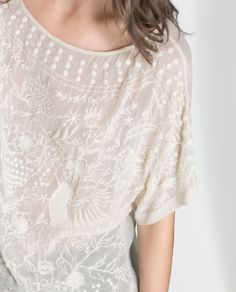 ZARA:: WOMAN:: BLOUSE WITH EMBROIDERED FRONT - Detailed View. See Zara.com @· ZARA ·
