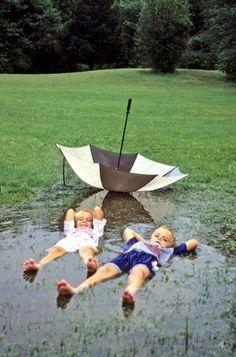 I love a rainy day. Kids; rain; umbrella