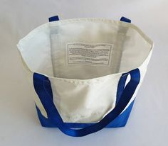 Durability and style come together in this snappy, one-of-a-kind sailcloth tote. Whether youre going to the farmers market, taking a six-pack and snacks to the shore or need a book bag for school or library, this Hoist Away bag is perfect. Functional and easy to care for it sits
