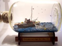 """""""Gabrielle Rogers and Stefan Auercraft ships in bottles. They received a special request to recreate a combination of scenes from the 1975 horror/thriller film Jawsand boy did they do an awesome job."""""""