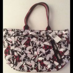NWT $88 LeSportsac Every Girl Tote Bag Set Primp NWT $88 LeSportsac Every Girl Tote Bag Set in Primp  Made in its signature ripstop nylon in colors of red white and black. This large and lightweight tote has a secure tote zipper on top, a large zippered front compartment under a pleated design, and a large zippered interior zippered area. A separate small matching zip pouch is included and attached.   In brand new condition with a tags attached. The print features glasses, gloves, lipstick…