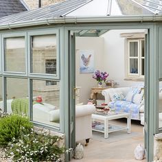 Green country conservatory with white walls and wooden flooring Decorating Conservatory Flooring, Small Conservatory, Conservatory Interiors, Conservatory Design, Style At Home, Garden Room Extensions, Living Room Images, Country Interior, Garden Buildings