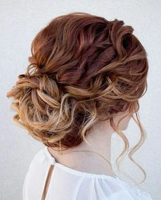 Twist and turn strokes of straight or curly hair to create this messy updo look. Haircolor is ombre Brown tot blonde hair