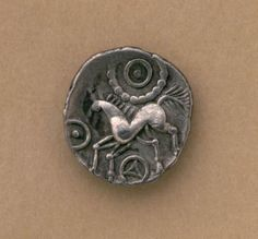 Silver Celtic Iceni unit. Britain, 1st century A.D.  The Iceni were a British tribe inhabiting the area around Norfolk from the 1st century B.C. to approximately the end of the 1st century A.D. They started using coins as a means of payment at around 10 B.C. This particular coin has a stylized horse depicted on it. Other coins would have equally stylized versions of animals.  Source: The Birmingham Museums and Art Gallery