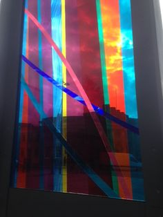 Colour- blocked glass panel outside a cathedral in Liverpool. Brings the designs of the stain glassed windows inside the building, outside.