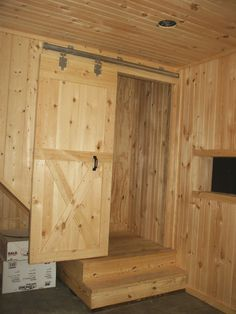 Installing a sliding door on stairway landing is one way to keep the heat from escaping through stairway opening in finished and heated tack room.