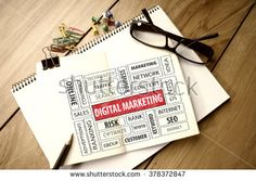 Business Concept: Digital Marketing word cloud on notebook
