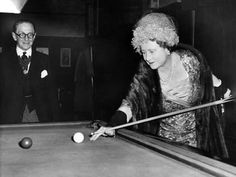 The Queen Mother having a go at pool/snooker