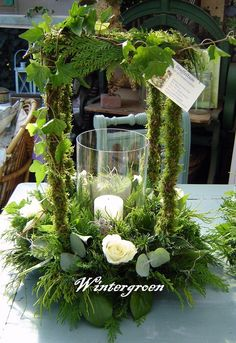 Use glass piece from candles and a candle in an arrangement similar. Arte Floral, Art Floral Noel, Deco Floral, Floral Design, Floral Centerpieces, Wedding Centerpieces, Wedding Table, Floral Arrangements, Wedding Decorations