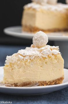 Raffaello Cheesecake - The taste of delicate Raffaello chocolates by Ferrero in a Cheesecake. Coconut cheesecake sits on top of an almond and coconut wafer crust and topped with crunchy coconut meringue. Beaux Desserts, Sweet Desserts, Just Desserts, Sweet Recipes, Baking Desserts, Coconut Cheesecake, Cheesecake Recipes, Cupcakes, Cupcake Cakes