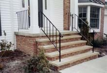 Similar front porch with iron railing