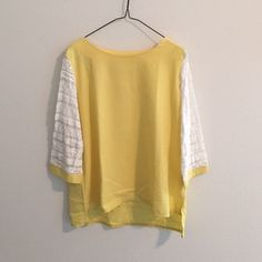 Yellow loose fit blouse with lace sleeves Cheery yellow blouse with pretty lace sleeves. Loose fit - can fit size M. Slight high-low design. Looks best when tucked into a skirt, shorts, or pants. Worn only once. In excellent condition. Tops Blouses