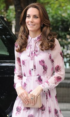 Kate Middleton emerged looking pretty in pink in a shirtdress by Kate Spade as she marked World Mental Health Day in London on Monday.