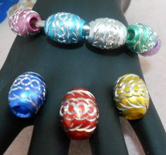 'Beautiful Aluminum Euro Style Beads' is going up for auction at 12pm Fri, Dec 14 with a starting bid of $5.