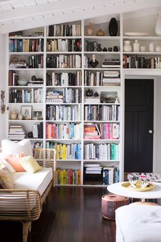 photography by lily glass for sfgirlbybay /  white built-in bookshelves with color-blocked books