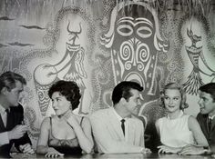 Oh, how I wish I could have been part of this group, anticipating my tiki cocktail in the Boom Boom Room. I'd be that guy on the far right, making eyes with the next guy over the beautiful woman's shoulder... #tikibars