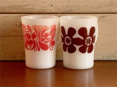 Retro vintage Pyrex coffee mugs 1960s with flower power graphics -- want