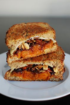 The Perfect Fall Grilled Cheese Sandwich - Thinly sliced butternut squash gets roasted with some maple syrup and chili powder for the next layer. As if that doesn't sound good enough, a big heaping pile of balsalmic caramelized onions get stacked on along with some slivered almonds for crunch. And last but not least, another layer of cheddar cheese. Wow!
