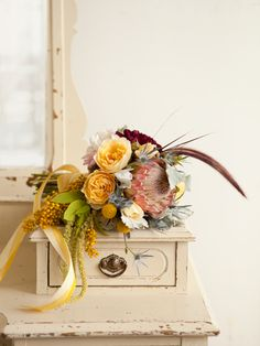 light pink, yellow, grey, with darker red flowers