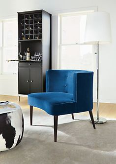 The curved, button-tufted back of this small-scale accent chair offers surprising comfort.