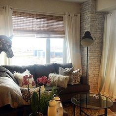 faux brick wall, ikea light, window treatments, bamboo window treatments, dark grey couch, small living room decor, tiny living room, cowhide, vittsjo, glass coffee table, round coffee table, rustic living room, encore designs,