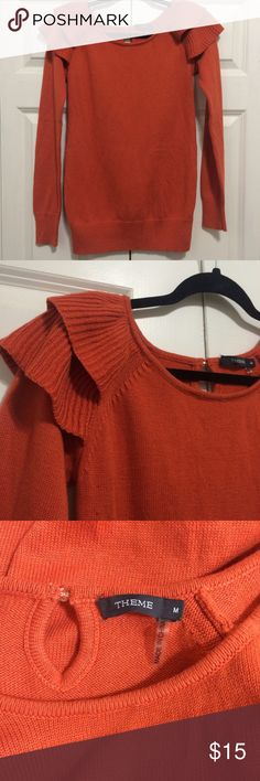 Ruffle shoulder sweater Orange 'Theme' brand sweater with ruffles on the shoulders. Size M. Fits pretty snug. Worn a few times but still great! Theme  Sweaters Crew & Scoop Necks