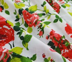 Description  * Fabric: Pure Cotton. * Print: Pink, Red and Green Floral Print. * Colour: White. * Transparency: Non-Transparent * Width: 40
