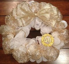 50th Anniversary Wreath I made for my Sisters  Mom and Dad in-law for their Anniversary. I think I made 3 or 4, but these were used as the centerpieces with a candle in the middle.