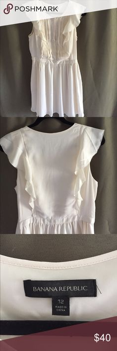 Banana Republic Flutter-Sleeve Pintuck dress. NWOT Ivory color. Never been worn. Super cute ruffle detail on back bodice. Dress is very light, comfortable and flowy. Banana Republic Dresses Midi