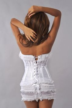 White Frilly Corset & Skirt Set 1034 Velvet Kitten  White frilly corset features lace ruffle trim, satin bow detail, side hook closure, lace-up back, and underwire cups. Includes matching ruffle skirt and satin thong.