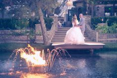 "The ""Fountains of Fire and Water."" with 5 spouting water fountains  and a beautifully landscaped ceremony site with a waterfall gently falling over large stones."