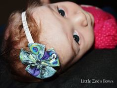 Peacock flower headband with rhinestone center on 1/8 elastic