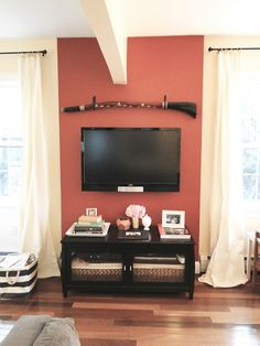 Michael asked what we could put under our tv if we mounted it. This is cute!