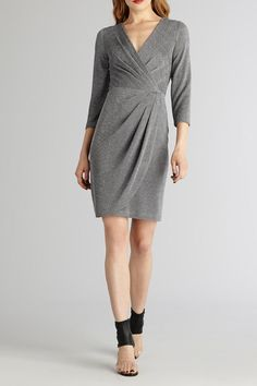 What sets this dress apart is its lovely draped front in a beautiful silver metallic fabric. Great for a night on the town.   Silver Metallic Dress by Donna Morgan. Clothing - Dresses New Jersey