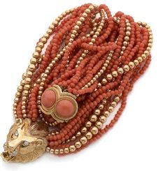 Collier torsade 8 rows of coral beads and 3 rows of gold beads, holding a lion's head in yellow gold, eyes and muzzle diamonds David Webb, Coral Bracelet, Coral Jewelry, Coral And Gold, Coral Orange, Cameo Jewelry, Jewelry Design, Dragon Bracelet, Animal Jewelry
