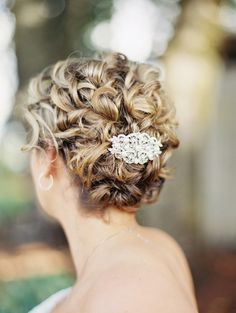 pretty curls with a beautiful crystal accessory for your wedding day