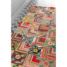 The Dash and Albert Rugs Hooked Gypsy Rose Area Rug has a colorful and vibrant design that stands out in any room. This area rug is made of wool and features a cotton backing that makes it smooth and durable. It is handmade, which makes it a one-of-a-kind addition to any home. This area rug has a beautiful multi-colored floral pattern. This Hooked Gypsy Rose Area Rug from Dash and Albert Rugs is available in multiple sizes that you can choose from. It is part of the Hooked collection and…