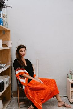 """Above: Patel-Cohn buys traditional saris in India and refashions them into modern, wearable pieces. """"For this design we used a black/orange ikat sari found in Bengal with a sheer stripe in the body."""" 
