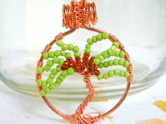 Copper Wire wrapped Tree of Life Pendant with Green and Brown Seed Beads