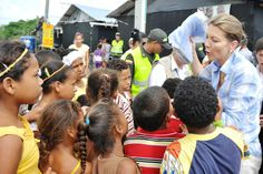 Maria Clemencia Rodrigues of Santos, the First Lady of Columbia handing out Twins for Peace rain boots in Colombia