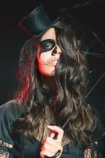 Fashion young woman going to Halloween party 2016. Beautiful hairstyle and scary makeup! Secret. Beautiful woman like doll with umbrella and hat. Halloween costumes. Role. Witch carnival costume