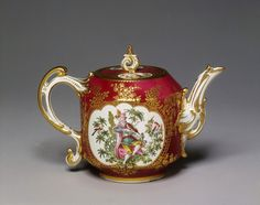 Teapot  Place of origin:   Chelsea, England (made)    Date:    1759-1769 (made)      Artist/Maker:    Chelsea Porcelain factory (maker)      Materials and Techniques:    Soft-paste porcelain, painted in enamel colours and gilt      Credit Line:    Bequeathed by Miss Emily S. Thomson      Museum number:   517      Gallery location:    British Galleries, room 52b, case 2  This teapot is relatively small, reflecting the high cost of tea in mid-18th-century Britain  v