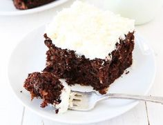 This rich and decadent chocolate zucchini cake is topped with a sweet toasted coconut frosting. It is a MUST make for zucchini season! Diet Recipes, Cake Recipes, Coconut Frosting, Zucchini Cake, Decadent Chocolate, Health Eating, Toasted Coconut, Cake Cookies, Food And Drink