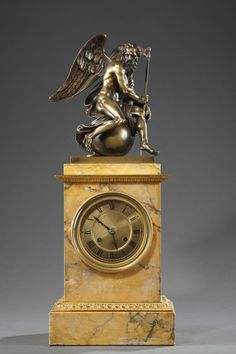 French 19th century mantle clock in Sienna marble and a bronze sculpture of Chronos
