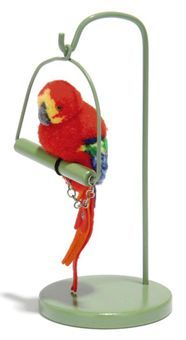 A STEIFF PARROT ON STAND, (1508,S), red, blue, yellow and green wool, brown and black glass eyes, felt tail feathers, chained, seated on perch with stand and small FF button, 1936-41 --7in. (18cm.) high