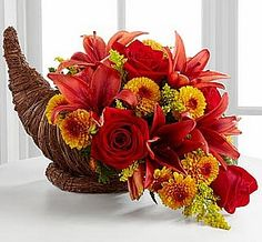 Have always wanted to do an arrangement in a cornucopia-see photo with Oasis inside one. Also YouTube. How to make a flower arrangement in a cornucopia