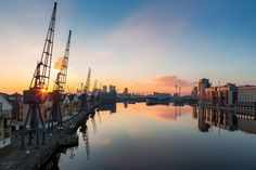 Sunset over the Royal Victoria Docks in London with the the Emirates Airline and Canary Wharf in the background. The Royal Victoria Dock is the largest of three docks in the Royal Docks of east London, now part of the redeveloped Docklands. Old London, East London, Emirates Airline, Beautiful London, River Thames, Continents, Landscape Photography, New York Skyline, Victoria
