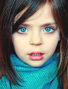 Baby blue eyes with brown hair, young girl, lips slightly parted, teeth showing. ©meyrembulucek