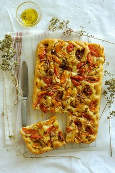ladenia - greek traditional kind of pizza with heirloom tomatoes