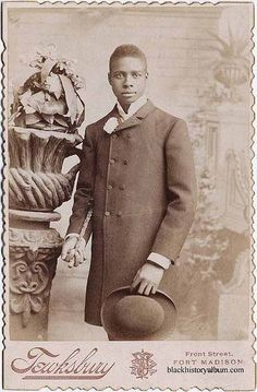 Gentleman, 1895  Three quarter length portrait, young man standing in frock coat, holding derby hat in left hand, walking stick in right. ca. 1895. Randolph L. Simpson African-American collection. Beinecke Rare Book and Manuscript Library, Yale University.